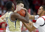 North Carolina State's Jericole Hellems, right, pressures Georgia Tech's Moses Wright (5) during the first half of an NCAA college basketball game at PNC Arena in Raleigh, N.C., Tuesday, Nov. 5, 2019. (Ethan Hyman/The News & Observer via AP)