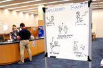 Social distancing rules are seen on a whiteboard near the entrance to the Nimitz Library at the U.S. Naval Academy, Monday, Aug. 24, 2020, in Annapolis, Md. Under the siege of the coronavirus pandemic, classes have begun at the Naval Academy, the Air Force Academy and the U.S. Military Academy at West Point. But unlike at many colleges around the country, most students are on campus and many will attend classes in person. (AP Photo/Julio Cortez)