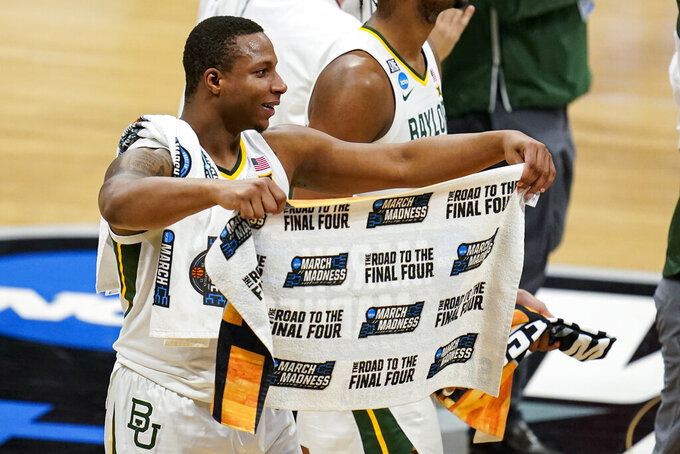 Baylor guard Mark Vital (11) celebrates after a 76-63 win over Wisconsin in a second-round game in the NCAA men's college basketball tournament at Hinkle Fieldhouse in Indianapolis, Sunday, March 21, 2021. (AP Photo/Michael Conroy)