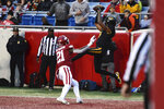 Missouri receiver Jonathan Nance makes a touchdown catch in front of Arkansas defender Montaric Brown during the second half of an NCAA college football game Friday, Nov. 29, 2019, in Little Rock, Ark. (AP Photo/Michael Woods)