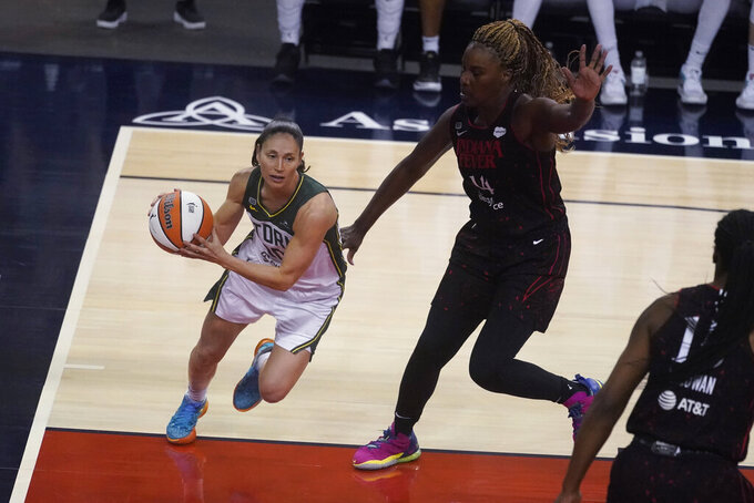Seattle Storm's Sue Bird drives as Indiana Fever's Jantel Lavender defends during the second half of a WNBA basketball game Thursday, June 17, 2021, in Indianapolis. (AP Photo/Darron Cummings)