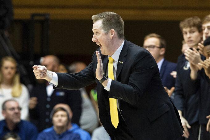 Wofford coach Jay McAuley directs his team during the first half of an NCAA college basketball game against Duke in Durham, N.C., Thursday, Dec. 19, 2019. (AP Photo/Ben McKeown)