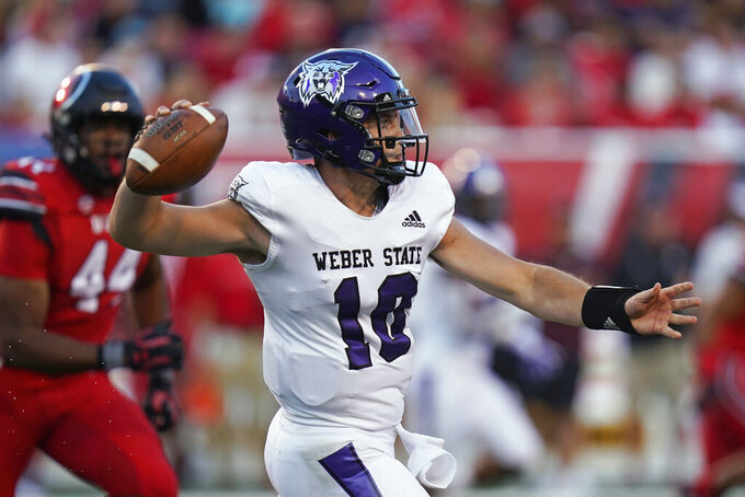 Weber State quarterback Bronson Barron (10) throws a pass during the first half of the team's NCAA college football game against Utah on Thursday, Sept. 2, 2021, in Salt Lake City. (AP Photo/Rick Bowmer)