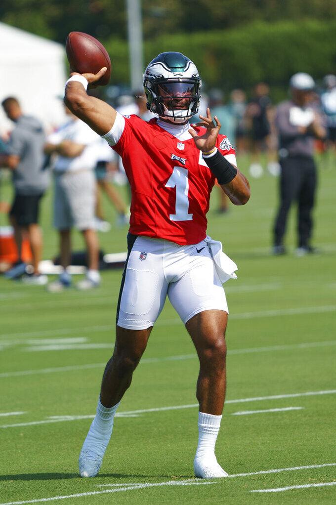 Philadelphia Eagles quarterback Jalen Hurts throws the ball during practice at NFL football training camp, Wednesday, July 28, 2021, in Philadelphia. (AP Photo/Chris Szagola)