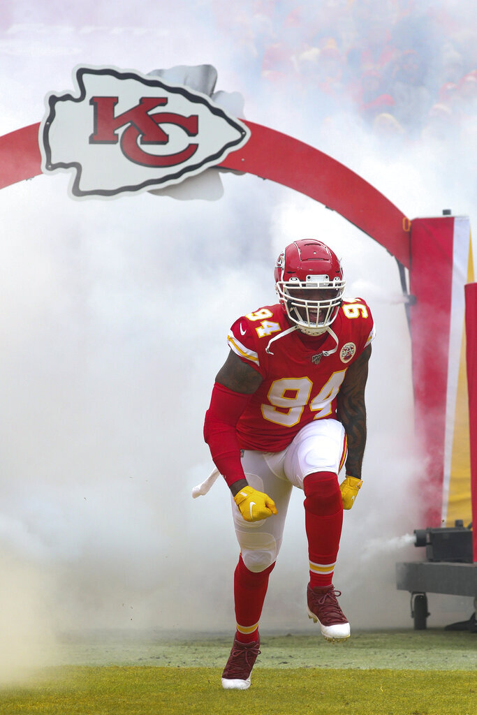 Kansas City Chiefs outside linebacker Terrell Suggs (94) celebrates as he enters the field prior to an NFL divisional playoff game against the Houston Texans, Sunday, Jan. 12, 2020 in Kansas City. The Chiefs defeated the Texans 51-31 (Margaret Bowles via AP)