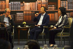 Huawei founder Ren Zhengfei, center, speaks at a roundtable at the telecom giant's headquarters in Shenzhen in southern China on Monday, June 17, 2019. Huawei's founder has likened his company to a badly damaged plane and says revenues will be $30 billion less than forecast over the next two years. (AP Photo/Dake Kang)