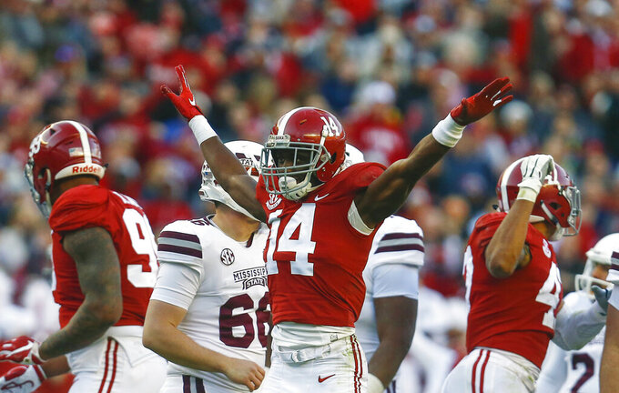 FILE - In this Nov. 10, 2018, file photo, Alabama defensive back Deionte Thompson (14) celebrates after Mississippi State place kicker Jace Christmann (47) missed a field goal-attempt during the first half of a game, in Tuscaloosa, Ala. Thompson is a possible pick in the 2019 NFL Draft. (AP Photo/Butch Dill, File)