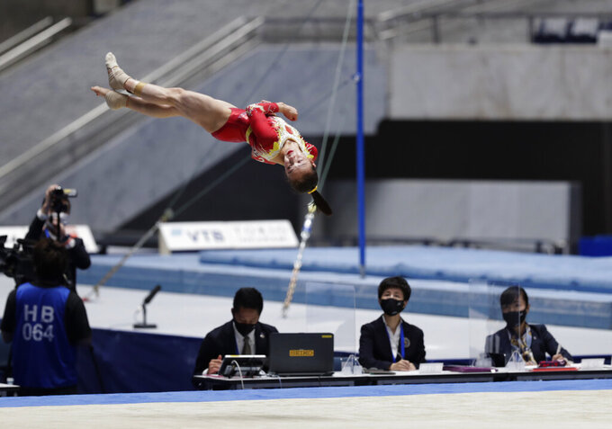 Zhang Jin of China competes in the floor exercise event in an international gymnastics meet in Tokyo on Sunday, Nov. 8, 2020. Gymnasts from four countries of China, Russia, U.S. and Japan performed in the meet at Yoyogi National Stadium First Gymnasium, a venue planned to be used in the Tokyo 2020 Olympics in the summer 2021. (AP Photo/Hiro Komae)