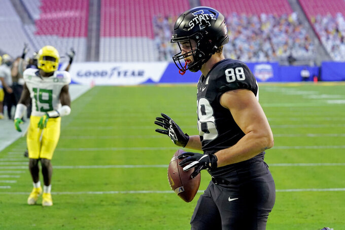 Iowa State tight end Charlie Kolar (88) scores a touchdown against Oregon during the first half of the Fiesta Bowl NCAA college football game, Saturday, Jan. 2, 2021, in Glendale, Ariz. (AP Photo/Ross D. Franklin)