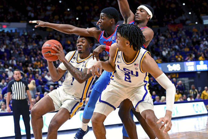 LSU guard Javonte Smart (1) runs into heavy traffic as Mississippi guard Bryce Williams, center, pressures and LSU forward Trendon Watford (2) watches in the first half of an NCAA college basketball game, Saturday, Feb. 1, 2020, in Baton Rouge, La. LSU won 73-63. (AP Photo/Bill Feig)