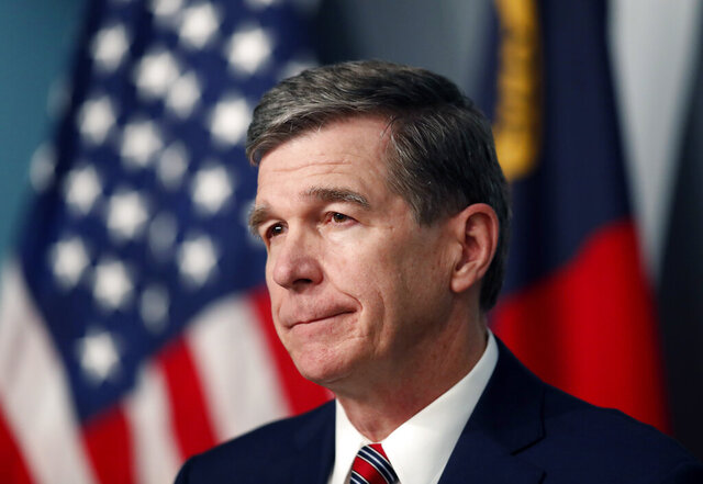 North Carolina Gov. Roy Cooper listens to a question during a briefing on the coronavirus pandemic at the Emergency Operations Center in Raleigh, N.C., Tuesday, May 26, 2020. (Ethan Hyman/The News & Observer via AP)