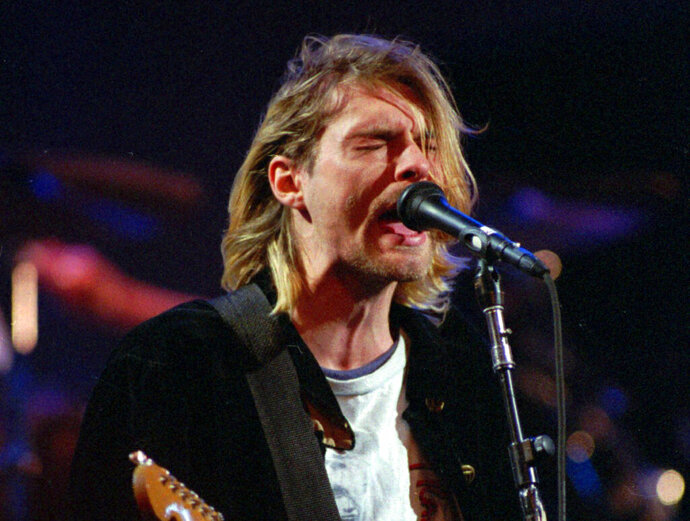 """FILE - This Dec. 13, 1993 file photo shows Kurt Cobain of the band Nirvana performing in Seattle. The Washington State Court of Appeals has ruled that photographs from the scene of Nirvana frontman Cobain's death will not be released publicly. KING5-TV reports the court ruled Tuesday, May 15, 2018, that the photographs are exempt from Washington state's Public Records Act and releasing the photos would """"violate the Cobain family's due process rights under the 14th Amendment.""""  (AP Photo/Robert Sorbo, File)"""