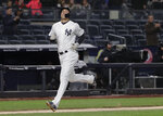 New York Yankees' Giancarlo Stanton runs home on a two-run home run by Didi Gregorius during the fourth inning of a baseball game against the Miami Marlins, Monday, April 16, 2018, in New York. (AP Photo/Julie Jacobson)