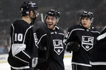Los Angeles Kings' Michael Amadio (10) is congratulated by teammates after assisting on a goal by Jeff Carter, not seen, during the second period of the team's NHL hockey game against the New York Islanders on Wednesday, Nov. 27, 2019, in Los Angeles. (AP Photo/Marcio Jose Sanchez)