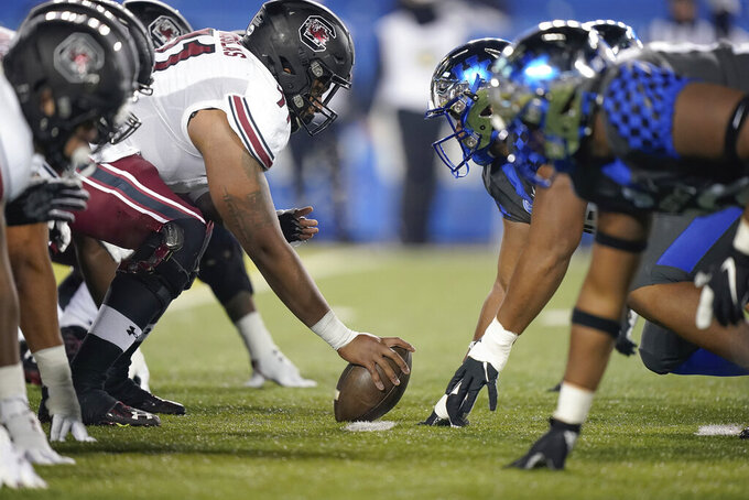 Players line up at the line of scrimmage during the first half of an NCAA college football game between Kentucky and South Carolina, Saturday, Dec. 5, 2020, in Lexington, Ky. (AP Photo/Bryan Woolston)