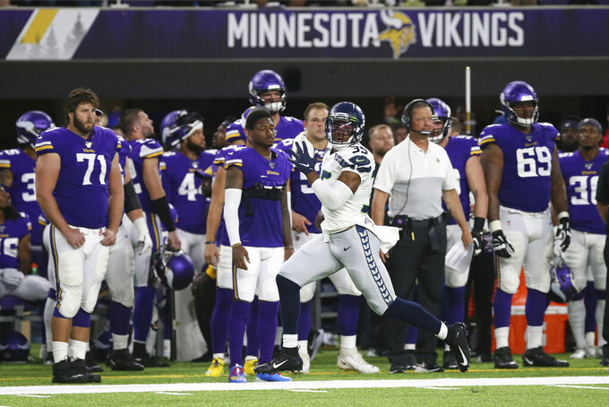 Seattle Seahawks' DeShawn Shead (35) returns an interception 88-yards for a touchdown during the first half of an NFL preseason football game against the Minnesota Vikings, Sunday, Aug. 18, 2019, in Minneapolis. (AP Photo/Jim Mone)