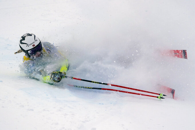 Norway's Thea Louise Stjernesund falls as she speeds down the course during an alpine ski, women's World Cup giant slalom in Courchevel, France, Saturday, Dec. 12, 2020. (AP Photo/Giovanni Auletta)
