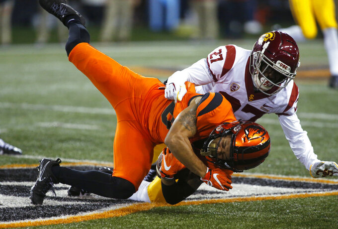 Ware runs for 205 yards, 3 TDs as USC beats Oregon St. 38-21