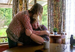 Carmall Casey, right, is embraced by Maxine Piper, a longtime friend and a source of support through Casey's addiction to opioids and battle with chronic pain, at her home in Black River, Tasmania, Australia, Tuesday, July 23, 2019. Casey doesn't know what she'll do when the pain returns. But she says she will never return to opioids.