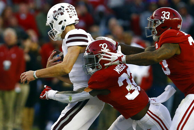 FILE - In this Nov. 10, 2018, file photo, Mississippi State quarterback Nick Fitzgerald (7) is sacked by Alabama linebacker Dylan Moses (32) and linebacker Anfernee Jennings (33) during the second half of an NCAA college football game, in Tuscaloosa, Ala. Moses was selected to The Associated Press preseason All-America first-team, Tuesday, Aug. 25, 2020. (AP Photo/Butch Dill, File)