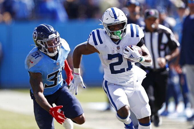 Indianapolis Colts running back Nyheim Hines (21) carries the ball past Tennessee Titans free safety Kevin Byard (31) in the second half of an NFL football game Sunday, Sept. 26, 2021, in Nashville, Tenn. (AP Photo/Wade Payne)
