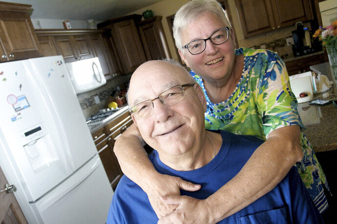 Roger and Vicki Roehl, of Mandan, N.D., want more people to know about the price inequities of prescription drugs from healthcare plans and Medicare. (Mike McCleary/Bismarck Tribune via AP)