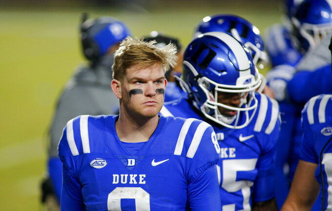 FILE - In this Dec. 5, 2020, file photo, Duke quarterback Chase Brice (8) stands on the sideline during the second half of the team's NCAA college football game against Miami in Durham, N.C. Appalachian State will switch to Duke transfer Brice at quarterback after Zac Thomas' three-year run. (Nell Redmond/Pool Photo via AP, File)