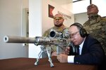 Russian President Vladimir Putin aims a sniper rifle during a visit to the Patriot military exhibition center outside Moscow, Russia, Wednesday, Sept. 19, 2018. Putin chaired a meeting that focused on new arms programs. (Alexei Nikolsky, Sputnik, Kremlin Pool Photo via AP)