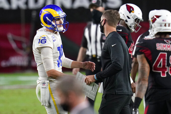 Arizona Cardinals head coach Kliff Kingsbury greets Los Angeles Rams quarterback Jared Goff (16) after an NFL football game, Sunday, Dec. 6, 2020, in Glendale, Ariz. The Rams won 38-28. (AP Photo/Ross D. Franklin)