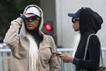 Shannade Clermont, left, and her twin sister Shannon leave Federal court in New York after her arraignment, Wednesday, July 11, 2018. Shannade Clermont, a former cast member of the television reality series