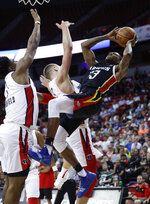 Atlanta Hawks' Thomas Wimbush, right, is fouled by Washington Wizards' Jemerrio Jones during the second half of an NBA summer league basketball game Thursday, July 11, 2019, in Las Vegas. (AP Photo/John Locher)