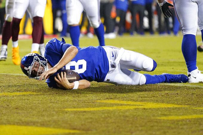 New York Giants quarterback Daniel Jones (8) scoring a touchdown against the Washington Football Team during the first half of an NFL football game, Thursday, Sept. 16, 2021, in Landover, Md. (AP Photo/Patrick Semansky)