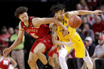 Minnesota's Amir Coffey (5) fouls Nebraska's Isaiah Roby (15) during the first half of an NCAA college basketball game in Lincoln, Neb., Wednesday, Feb. 13, 2019. (AP Photo/Nati Harnik)
