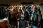 """This image released by Universal Pictures shows Dylan Arnold, from left, Andi Matichak and Robert Longstreet in """"Halloween Kills,"""" directed by David Gordon Green. (Ryan Green/Universal Pictures via AP)"""