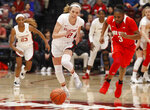 Stanford's Lexie Hull (12) recovers the ball during the first half of an NCAA college basketball game against Ohio State, Sunday, Dec. 15, 2019, in Stanford, Calif. Ohio State's Janai Crooms (3) looks on. (AP Photo/George Nikitin)