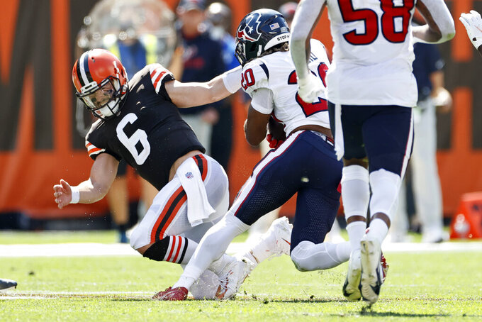 Cleveland Browns quarterback Baker Mayfield (6) is hurt trying to tackle Houston Texans strong safety Justin Reid (20) during the first half of an NFL football game, Sunday, Sept. 19, 2021, in Cleveland. (AP Photo/Ron Schwane)