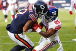 New York Giants defensive back Corey Ballentine (25) tries to strip the ball from Chicago Bears wide receiver Allen Robinson (12) who is on his way to a Bears touchdown during the second half of an NFL football game in Chicago, Sunday, Nov. 24, 2019. (AP Photo/Charles Rex Arbogast)