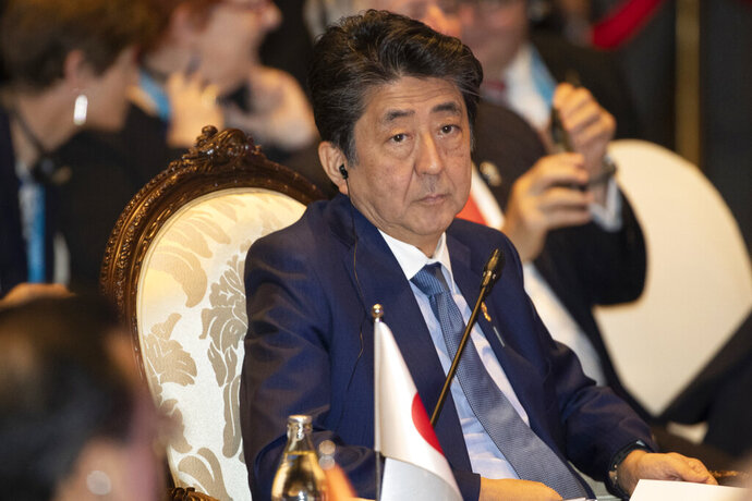 FILE - This Nov. 4, 2019, file photo, Japan's Prime Minister Shinzo Abe, attends East Asia summit in Nonthaburi, Thailand. North Korea has called Japanese Prime Minister Shinzo Abe an