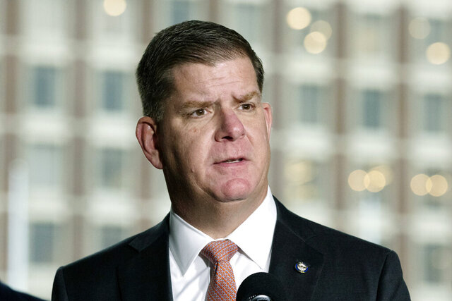 FILE - In this March 13, 2020 file photo, Boston Mayor Marty Walsh talks about the postponement of the Boston Marathon during a news conference, in Boston.  President-elect Joe Biden has selected Boston Mayor Marty Walsh as his labor secretary, choosing a former union worker who shares his Irish American background and working-class roots. The 53-year-old Walsh has served as the Democratic mayor of Boston since 2014. (AP Photo/Michael Dwyer)