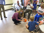 U.S. Sen Kelly Loeffler autographs a basketball, Thursday, Sept 3, 2020, at a campaign stop in Cumming, Ga. Two Black Lives Matter activists kept Loeffler from finishing a campaign speech. (AP Photo/Jeff Amy)