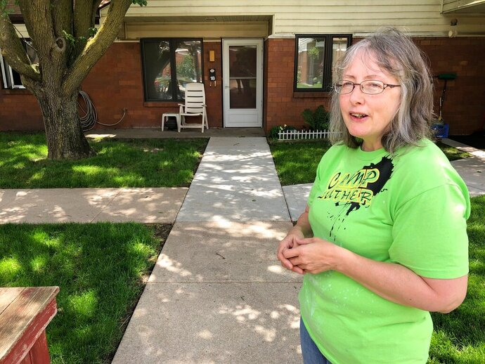 In this June 14, 2019 photo, Marti Poll, 55, discusses her struggle to get health care for a variety of conditions outside her apartment complex outside of Lincoln, Nebraska. Poll is one of the estimated 90,000 people who could get coverage under the Medicaid expansion measure approved by voters in November, but some critics say state officials are taking too long to launch the program. (AP Photo/Grant Schulte)