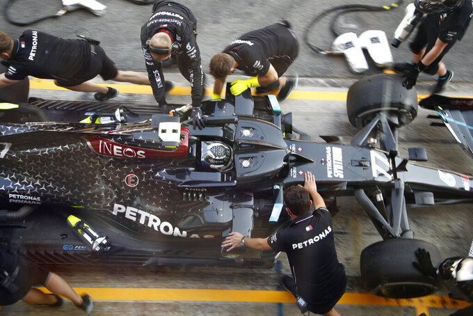 Mercedes driver Valtteri Bottas of Finland stops in the pits during the second practice session prior to the Formula One Grand Prix at the Barcelona Catalunya racetrack in Montmelo, Spain, Friday, Aug. 14, 2020. (AP Photo, Emilio Morenatti, Pool)