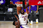 Los Angeles Lakers' Anthony Davis (3) dunks against Miami Heat's Jimmy Butler (22) and Jae Crowder (99) during the first half in Game 6 of basketball's NBA Finals Sunday, Oct. 11, 2020, in Lake Buena Vista, Fla. (AP Photo/Mark J. Terrill)