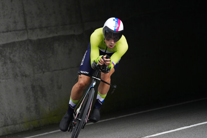 Primoz Roglic of Slovenia competes during the men's cycling individual time trial at the 2020 Summer Olympics, Wednesday, July 28, 2021, in Oyama, Japan. (AP Photo/Christophe Ena)