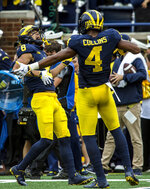 Michigan wide receiver Ronnie Bell (8) celebrates with wide receiver Nico Collins (4) after Bell makes a 22-yard touchdown catch in the second quarter of an NCAA college football game against Maryland in Ann Arbor, Mich., Saturday, Oct. 6, 2018. (AP Photo/Tony Ding)