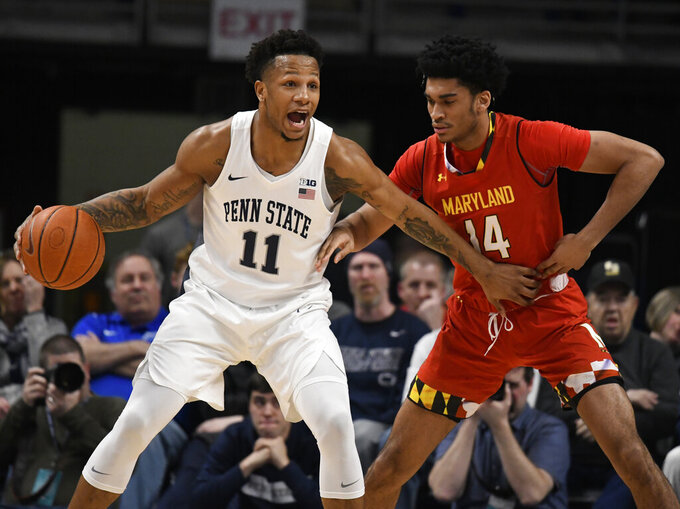 Penn State forward Lamar Stevens (11) tries to get past Maryland forward Ricky Lindo Jr., (14) during the first half of an NCAA college basketball game Wednesday, Feb. 27, 2019, in State College, Pa. (AP Photo/John Beale)