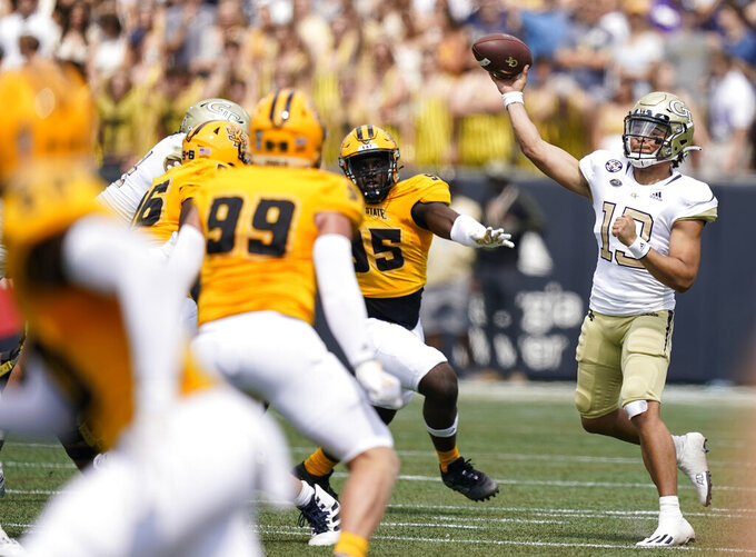 Georgia Tech quarterback Jordan Yates (13) passes the ball against Kennesaw State during the first half of an NCAA college football game, Saturday, Sept. 11, 2021, in Atlanta. (AP Photo/Brynn Anderson)