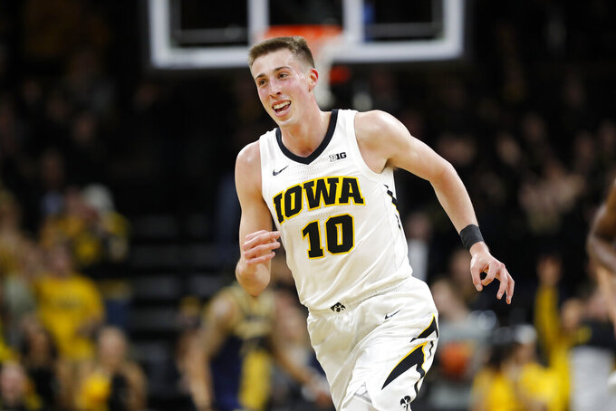 Iowa guard Joe Wieskamp smiles after making a 3-point basket during the first half of the team's NCAA college basketball game against Michigan, Friday, Feb. 1, 2019, in Iowa City, Iowa. (AP Photo/Charlie Neibergall)