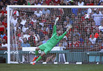 Liverpool goalie Andy Longergan is unable to make the save on a goal by Sevilla's Aguido Duran Manuel during the first half of a friendly soccer game at Fenway Park, Sunday, July 21, 2019, in Boston. (AP Photo/Mary Schwalm)