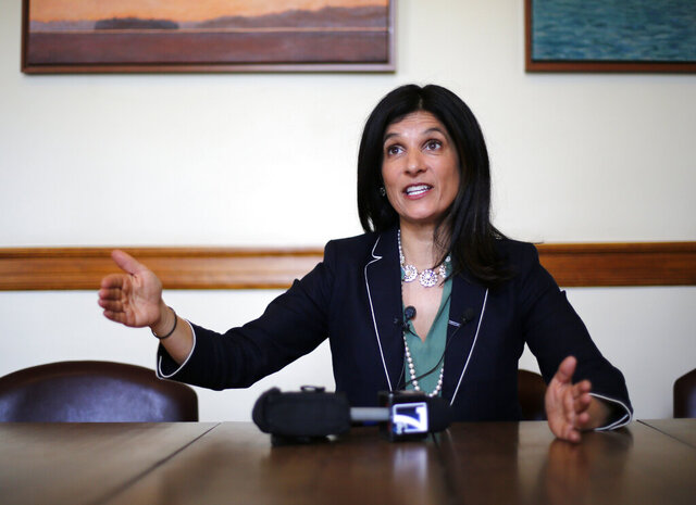 FILE - In this May 5, 2018, file photo, Speaker of the House Sara Gideon, D Freeport, speaks to reporters in her office at the State House, in Augusta, Maine. Gideon is driving home her attack on GOP Sen. Susan Collins for accepting corporate donations. (AP Photo/Robert F. Bukaty, File)